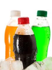 cold bottles of soda in ice