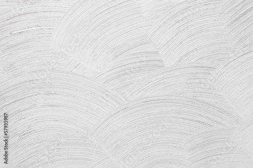 Closeup white concrete wall texture with round plaster decorativ