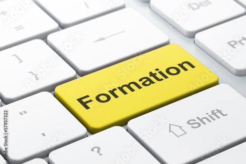 Education concept: Formation on computer keyboard background