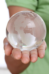 Hand holding glass globe