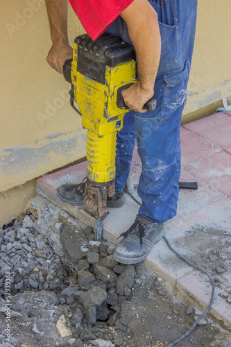 Builder worker with electric jackhammer 2
