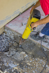 Builder worker with electric jackhammer 4