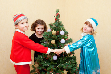 Children dancing around the Christmas tree.