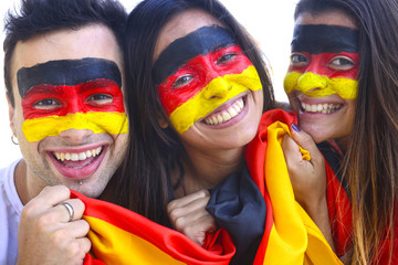 Group of happy german soccer fans commemorating victory.