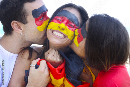 Greman fans commemorating victory kissing