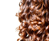 Fototapety Hair isolated on white. Border of Curly Brown Long Hair