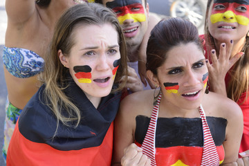 German group of soccer fans disappointed with team defeat.