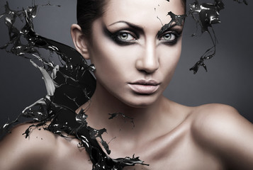 close up portrait of sexy brunette woman with black splash