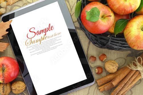 Leinwandbild Motiv Autumn background basket with apples and tablet