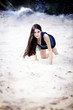 Woman on cosmic beach