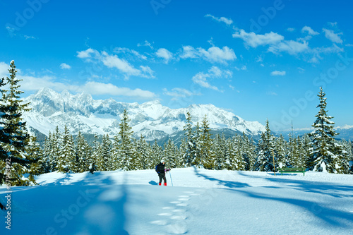 Winter mountain landscape and woman on walk