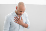 Casual young man with chest pain