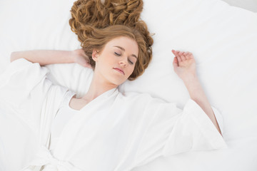 Overhead view of pretty blond sleeping in bed