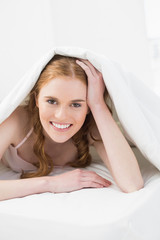 Portrait of a pretty young woman in bed