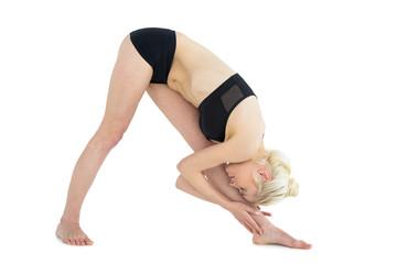 Full length of sporty woman bending down to her leg
