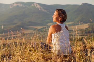 Woman enjoyed with gently shining sunrise