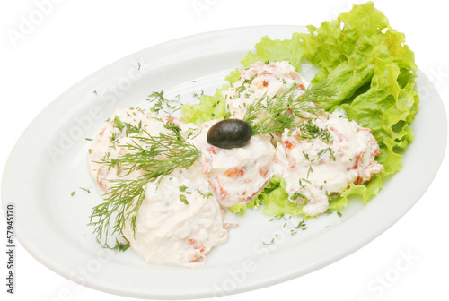 Fresh salad with cocumbers and milk sauce