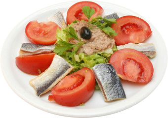 Salad with tomatoes and fish fillet