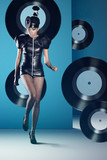 Disco woman dancing with vinyl records
