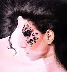 flower woman with creative hair and face art with rhinestone