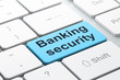 Protection concept: Banking Security on keyboard background