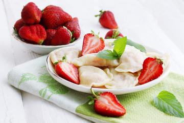Dumplings with fresh strawberries
