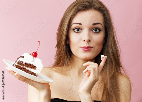Woman eating cream finger