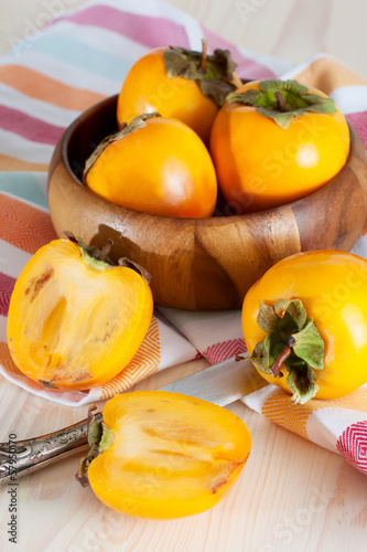Persimmons in bowl