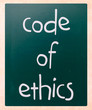 """Code of ethics"" handwritten with white chalk on a blackboard"