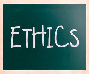 """Ethics"" handwritten with white chalk on a blackboard"
