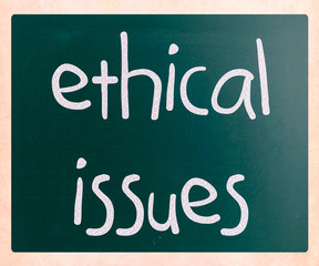 """Ethical issues"" handwritten with white chalk on a blackboard"