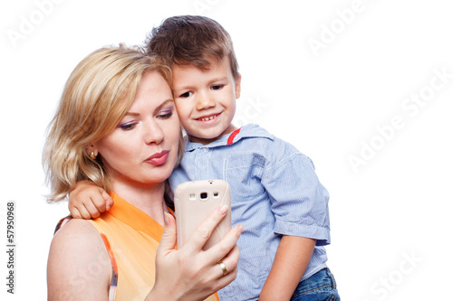 Happy mother with son and smartphone
