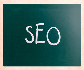"The word ""SEO"" handwritten with white chalk on a blackboard"