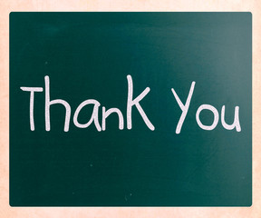 """Thank you"" handwritten with white chalk on a blackboard"