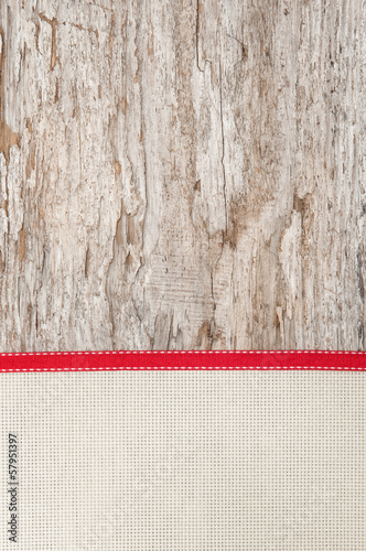 Christmas decoration with red ribbon and canvas