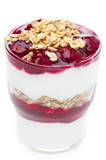 close-up of layered dessert with yogurt, granola and cherry