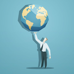 Businessman holding the world in his hands