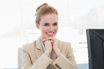 Portrait of smiling young businesswoman with computer