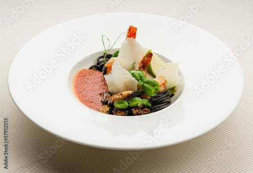 Black spaghetti with seafood,parmesan and tomato sauce