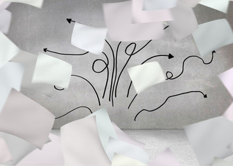 Papers in front of grey wall with arrows