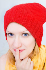 Portrait of a girl in a red cap. Blue eyes. Big nose. smile