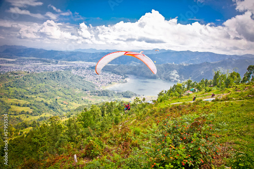 Paragliders take off from Sarangkot, Pokhara valley. Nepal.