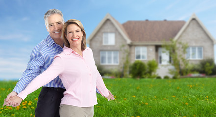 Senior couple near new home.