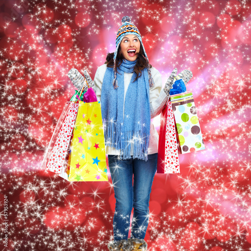 Girl with shopping bags over Xmas background.