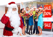Santa Claus and group of happy people.