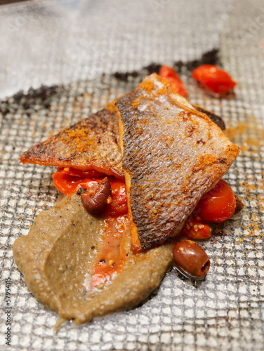Seabass fillet cooked in Sicilian way