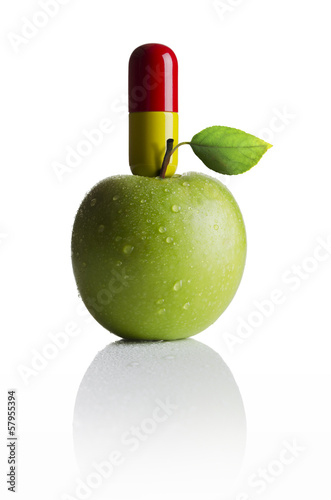 Apple with a medicine pill