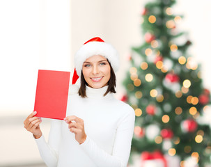 woman in santa helper hat with blank red card