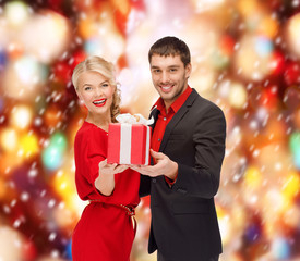 smiling woman and man with gift box
