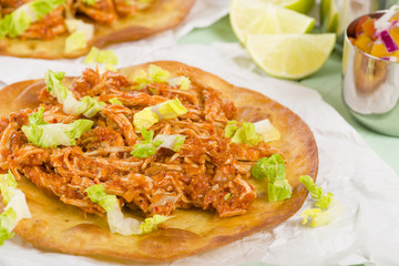Tostadas - Mexican crispy tortilla with spicy chicken tinga